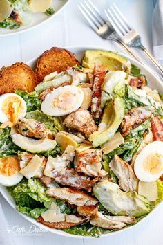 Chicken and Avocado Caesar Salad made with a low in fat healthier dressing; grilled chicken and crunchy ciabatta croutons cafedelites.com