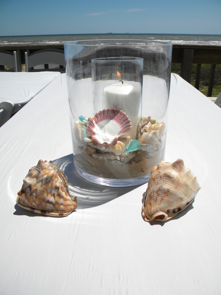 beach wedding decor simple idea just get a jar and throw some sea shells