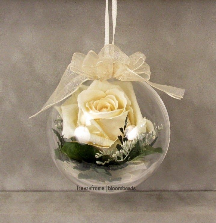 Preserved flowers in ornament - want to do one for the Christmas tree!