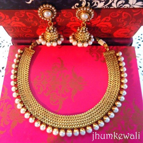 Indian: Line of PEARLs necklace with earrings.  http://www.craftsvilla.com/catalog/product/view/id/310694/s/gold-n-line-of-pearls-necklace-with-jhumkas/category/33/
