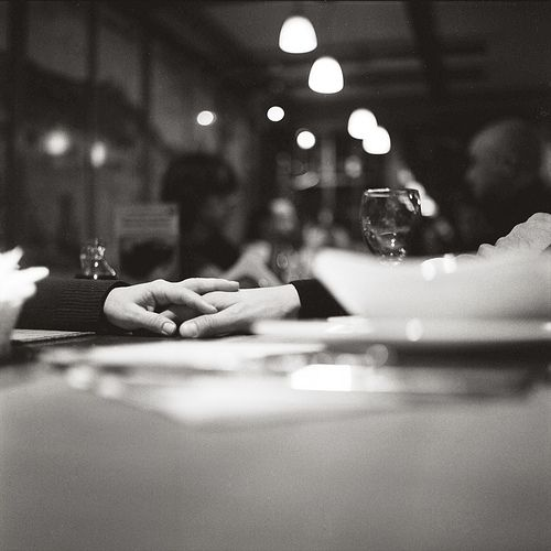 Photography by Alex Mazurov.  cafe, restaurant, wine, couples, love, hands, holding hands, black and white, urban, evening,
