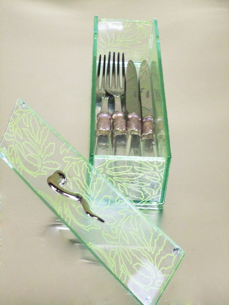 Glass cutlery box with lid as cutlery holder. Box is designed in mint green color with leaves pattern. Design by Glass Studio