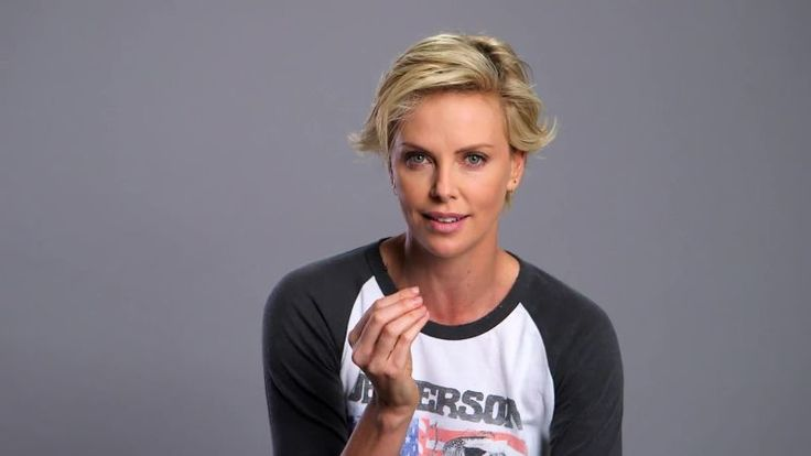 charlize theron -- bad hair day --  this is the haircut that I do NOT want..    Long layers on top w/ short sides that grow out weird..