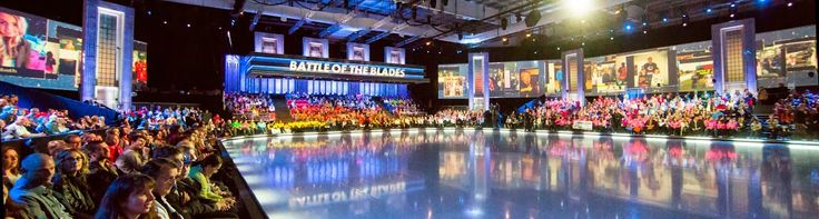 A still of the social TV integration we're doing for Battle of the Blades. The approach allows us to bring in audience photos from across Canada and integrate them into the show, pretty much live.   You can see these fan photos on the projector walls around the arena, just above the live audience.  A bunch of tech was used to make this.   It would be impossible to do this with conventional TV production techniques.