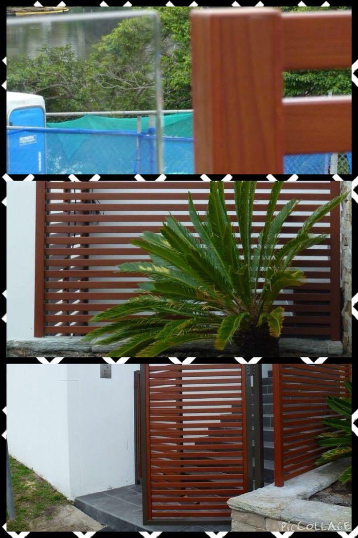 Aluminium slats with glass pool fencing