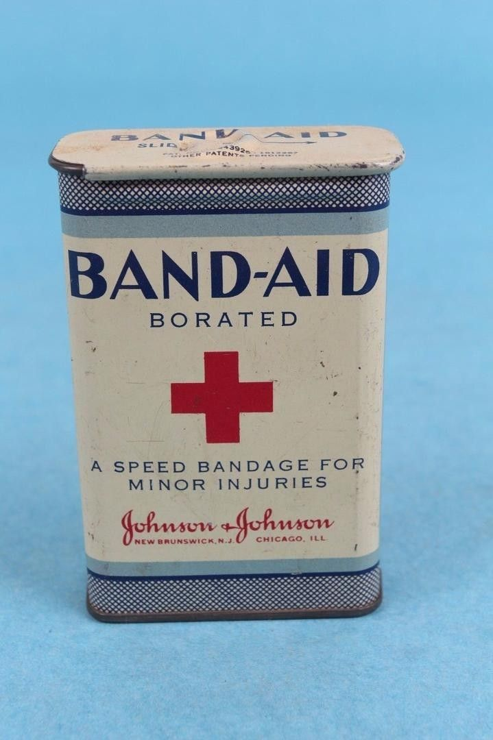 $50 ITEM: VINTAGE 1920-30's JOHNSON & JOHNSON SLIDE TOP BAND AID ADVERTISING TIN CONTAINER. Container is empty of all contents. CONDITION: Piece is in good condition for age with light surface scratches a