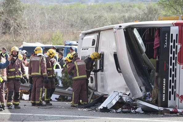 Firefighters are seen at the scene of an accident after a bus carrying university exchange students back from a popular festival crashed near Tarragona in north-east Spain, on March 20, 2016. (Photo by Tjerk van der Meulen/Anadolu Agency/Getty Images)