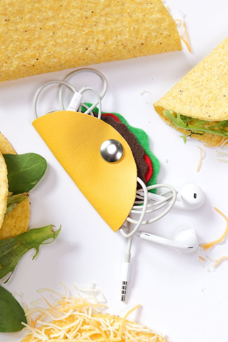 Use this simple tutorial to make a DIY taco headphone organizer to wrap your headphones in to prevent tangling! They're easy to make using leather and felt.
