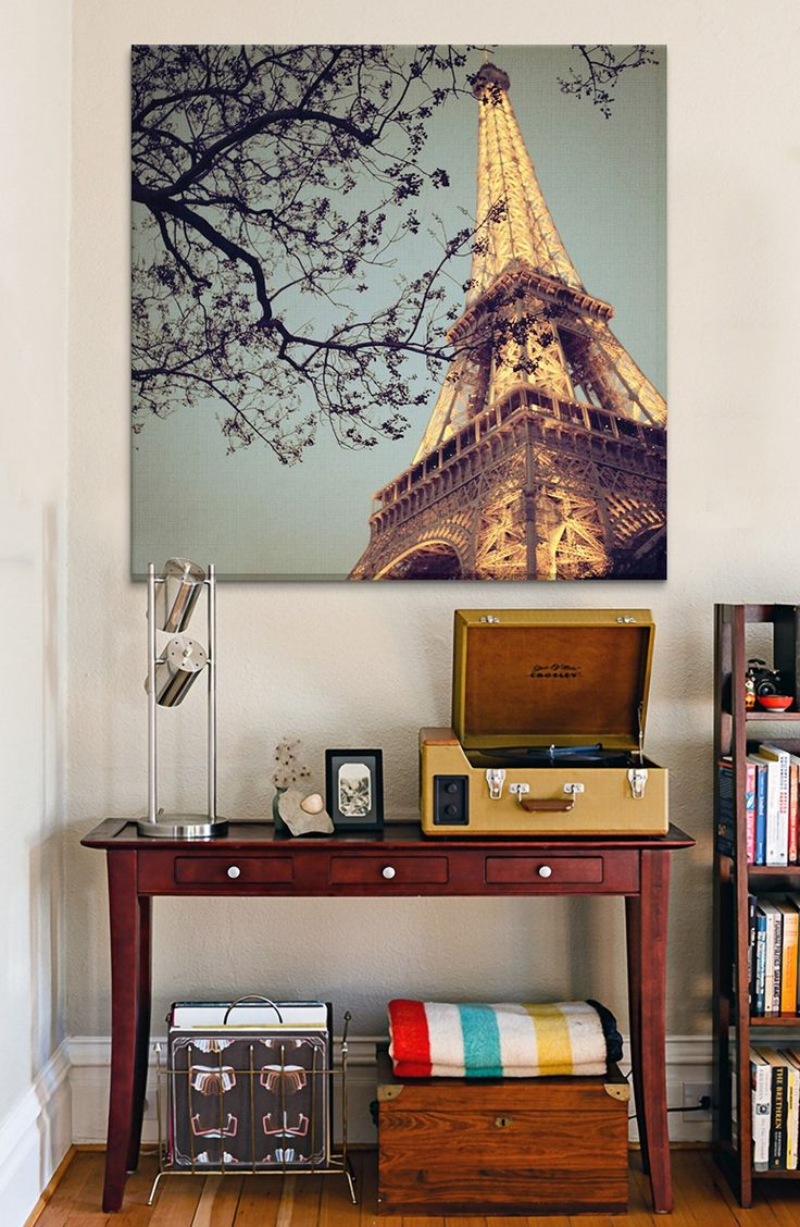 This stunning canvas print of the Eiffel Tower is sure to liven up any living room.