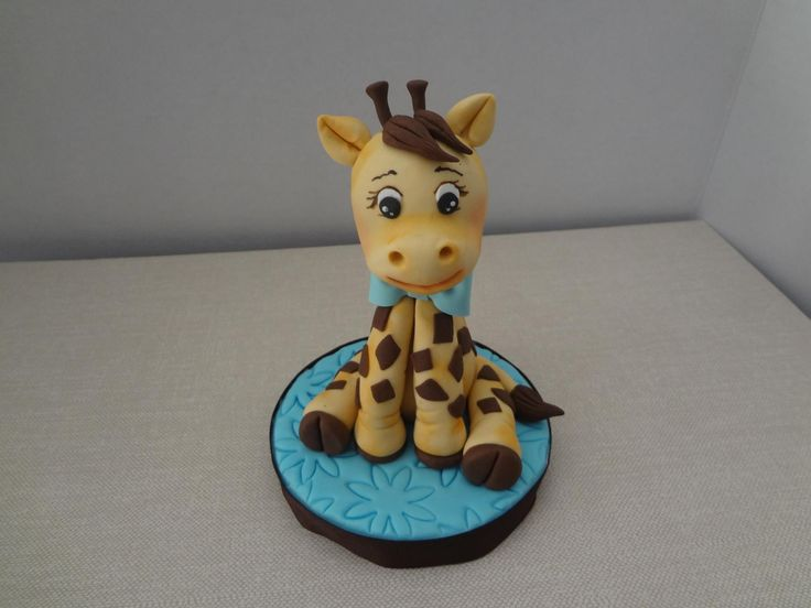 Baby Giraffe Cake Topper - Gumpaste Baby Giraffe Hand made no molds used. Please check out my website www.rocioscakesupplies.com for videos on how to create it