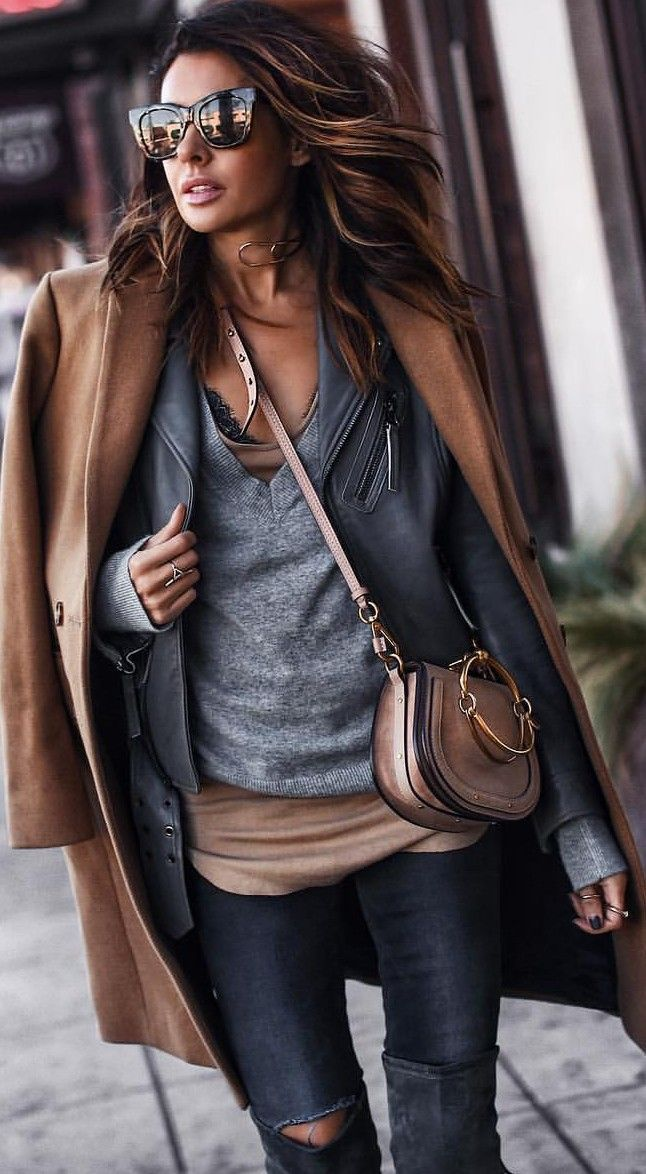Casual layering. Casual street style outfit inspiration. Brown and grey color combination. Chic fall and winter outfit. Grey sweater + brown coat + leatherjacket + brown bag. #streetstyle #casualoutfit #falloutfit #winteroutfit #layeroutfit #chicoutfit #comfyoutfit #browncoat #greysweater #leatherjacket