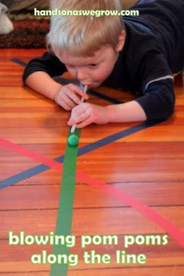 With just some coloured tape you can get your kids to practise their motor skills and their coordination:walk the line  and blowing pom poms along the line