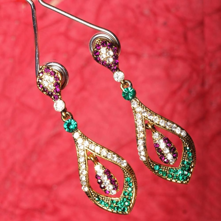 These earrings look very elegant and feminine when worn. The cute leaf at the bottom has made it all the more very girly and cute.      Fashion Statement      You may try them with some of your traditional dresses.