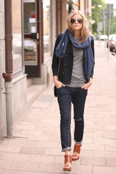 Try pairing a black pea coat with navy blue destroyed jeans for a glam and trendy getup. Take a classic approach with the footwear and grab a pair of tobacco leather heeled sandals.  Shop this look for $100:  http://lookastic.com/women/looks/sunglasses-scarf-crew-neck-t-shirt-pea-coat-crossbody-bag-jeans-heeled-sandals/5582  — Dark Brown Sunglasses  — Navy Cotton Scarf  — Grey Crew-neck T-shirt  — Black Pea Coat  — Black Leather Crossbody Bag  — Navy Ripped Jeans  — Tobacco Leather Heeled…
