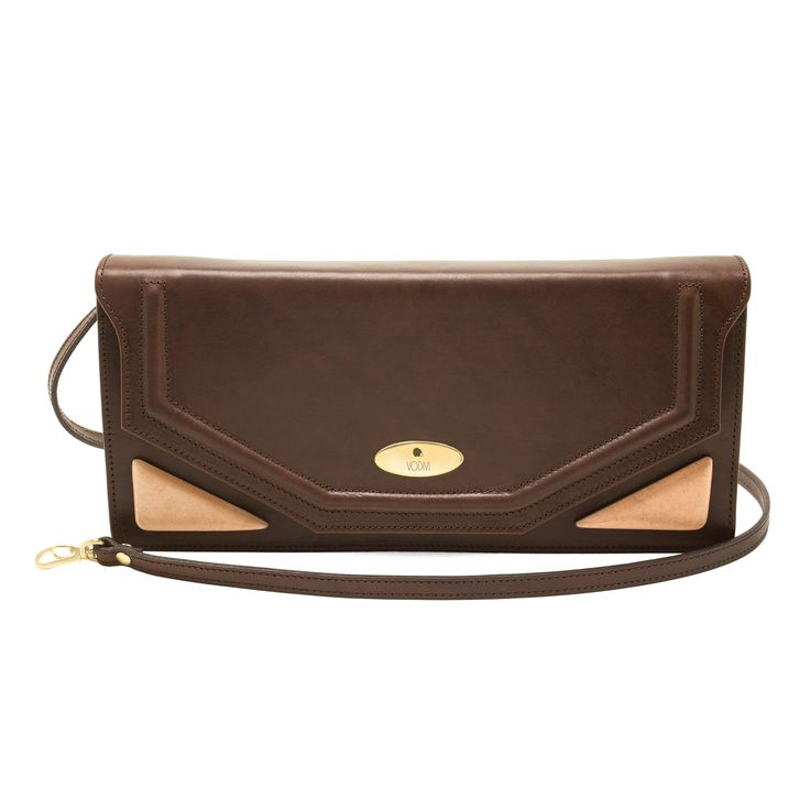 SIBILLA A clutch that embodies in itself,  like an ancient book,  the mystery of the Apennine Sibyl,  mythical inhabitant of the cave of the same name. Tuscan hand-colored vegetable-tanned leather woman's handbag. http://www.vodivi.com/shop/en/home/14-sibilla.html