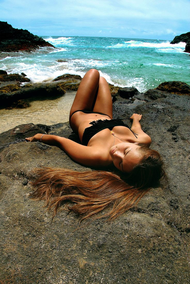 tanning on the beach photography. sun bathing on the beach tanning photography