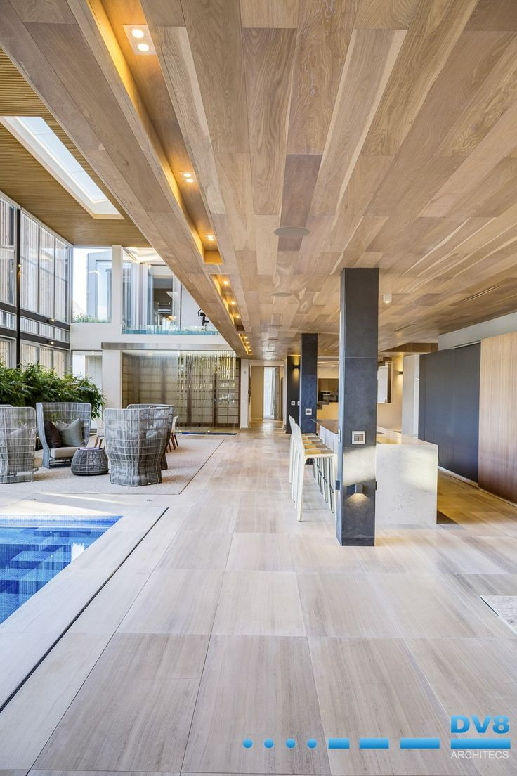 Modern Japanese home inspired by Katei. Oak ceilings with indoor pool and indoor planting. Double volume with slatted ceilings and skylight. Wabi Sabi.