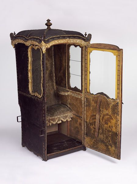 Sedan chair, Italy, ca. 1750, black leather exterior, side windows slide back, front window is made to drop downwards, door is designed to be completely removed. Click on image for more information. V&A