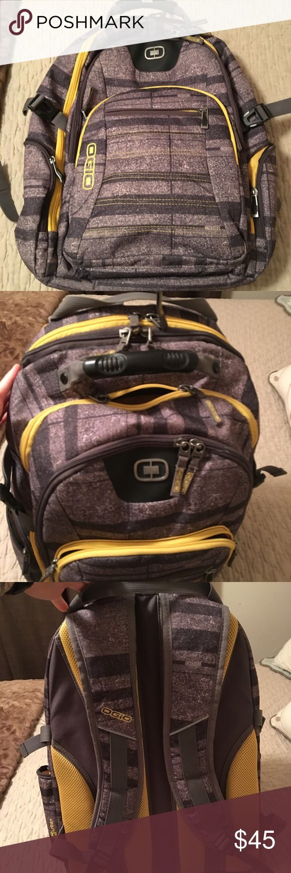 OGIO Travel Tech Backpack Gray and yellow plaid travel tech backpack. 2 large main pockets with 5 additional pockets accessible from outside. Checkpoint friendly zipper allows you to keep the laptop in bag. Extra zippers and storage inside both main pockets. Padding on back area for airflow and protection from heavy bag. Very durable, great condition. OGIO Accessories