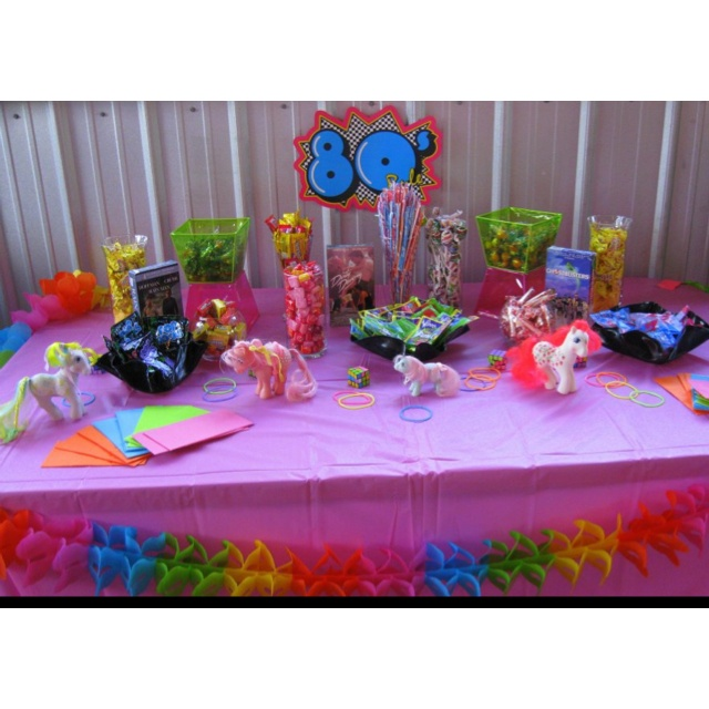 80's candy buffet - pop rocks, fun dip, starburst, smarties, bow pops, gobstoppers, sweet tarts, gum, pixie stix with some 80s nostalgia it looks totally awesome!