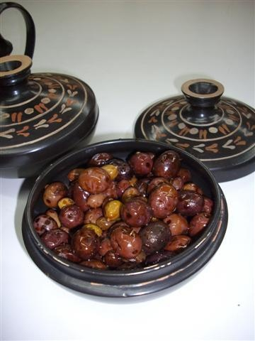 Olives preserved in petimezi. I served them in a pyxis (box with lid).