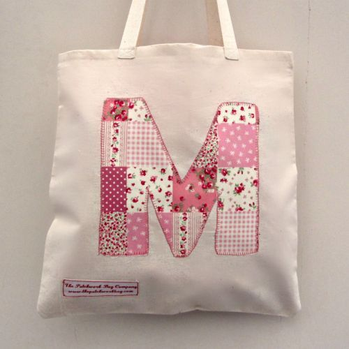 A gorgeous little #childrens personalised tote bag is perfect for your child's PE kit at School. #Appliqued from pink patchwork fabric, your initial or name can be added horizontally or diagonally across the bag. A cute little bag for your childs favourite teddy when they go to Pre-School.