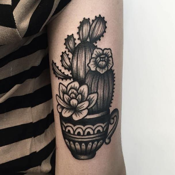 Cactus tattoos are cool and look even better in nothing but black ink.