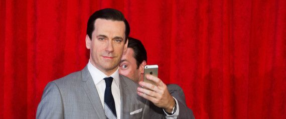 Jon Hamm Takes Selfies With His wax Statue.
