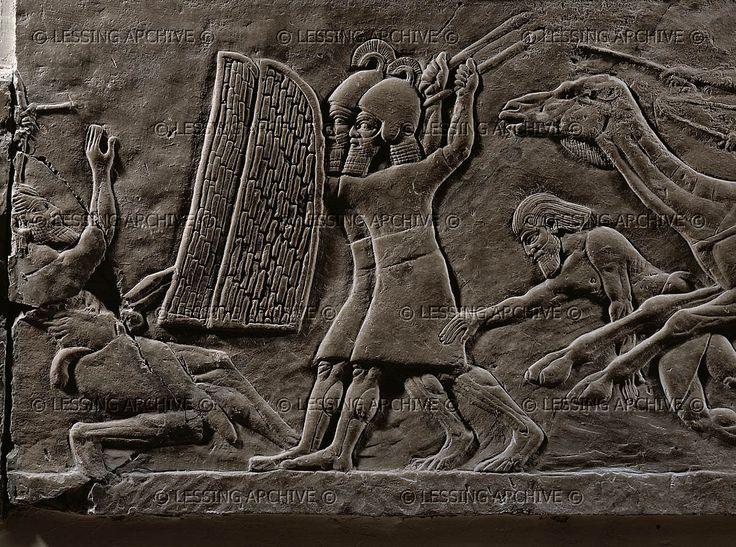 assyrian warriors shelter behind shields battle against arabian