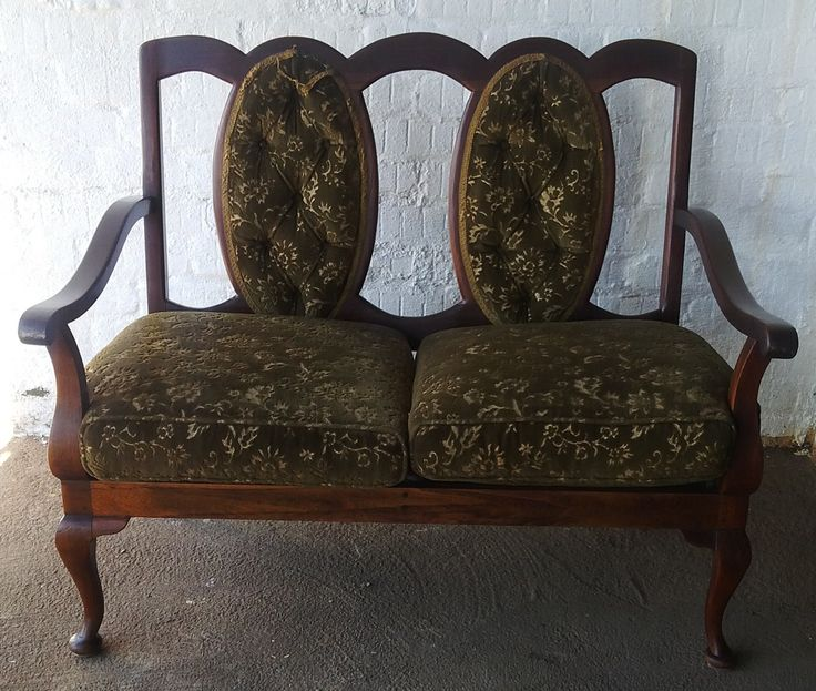 SOLD! #NorthcliffAntiques Vintage two seater lounge chair, part of a lounge suite consisting of this piece and two single arm chairs. Wood: Imbuia. Finish: Varnish. Chair details: two-seater chair with armrests, with French buttoned-back and upholstered in green floral velvet. Legs: Plain cabriole in the front ending in padded feet and sabre style back legs. #Johannesburg #Imbuia #Vintage #Chair #Furniture #Wood #LoungeSuite