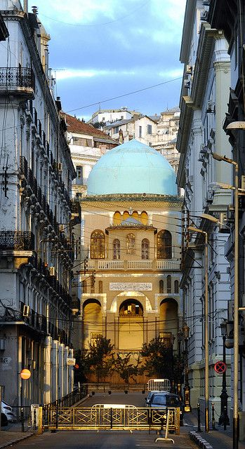 Algeria - Ibn Badis Mosquee. Facts about Algeria. Area: 2,381,741 sq km. Agriculture is possible on the Mediterranean coast, in the Atlas Mountains and at oases; 80% is desert. Population: 35,422,589. Capital: Algiers.  Official language: Arabic and Berber. French and English are widely used, and 25% speak one of the Berber languages. Languages: 22
