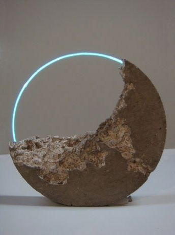 """Employing the technology of luminous gas and glass, Sarah Blood creates minimalistic sculpture work with neon lamps and concrete. Her work is absolutely stunning and bleak, aggressively combining two very different materials."""