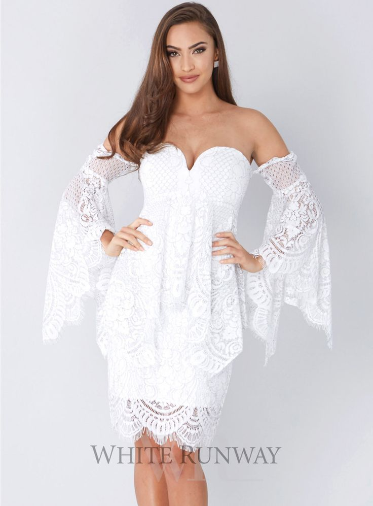 Empire Peplum Bustier Mini. A gorgeous mini dress by Shona Joy. Beautiful lace style featuring a 'u' wire neckline, fitted bodice with boning and flared sleeves.
