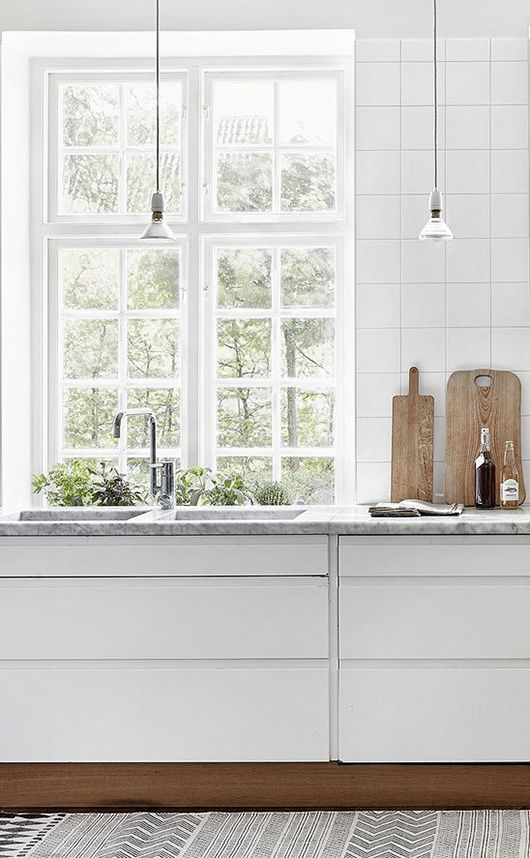 marble countertops and white tile in modern kitchen / sfgirlbybay