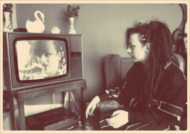Boy George watching himself on TV. Meta. Born George Alan O'Dowd in 1961, Boy George is an English singer-songwriter, who was part of the English New Romanticism movement which emerged in the early 1980s.