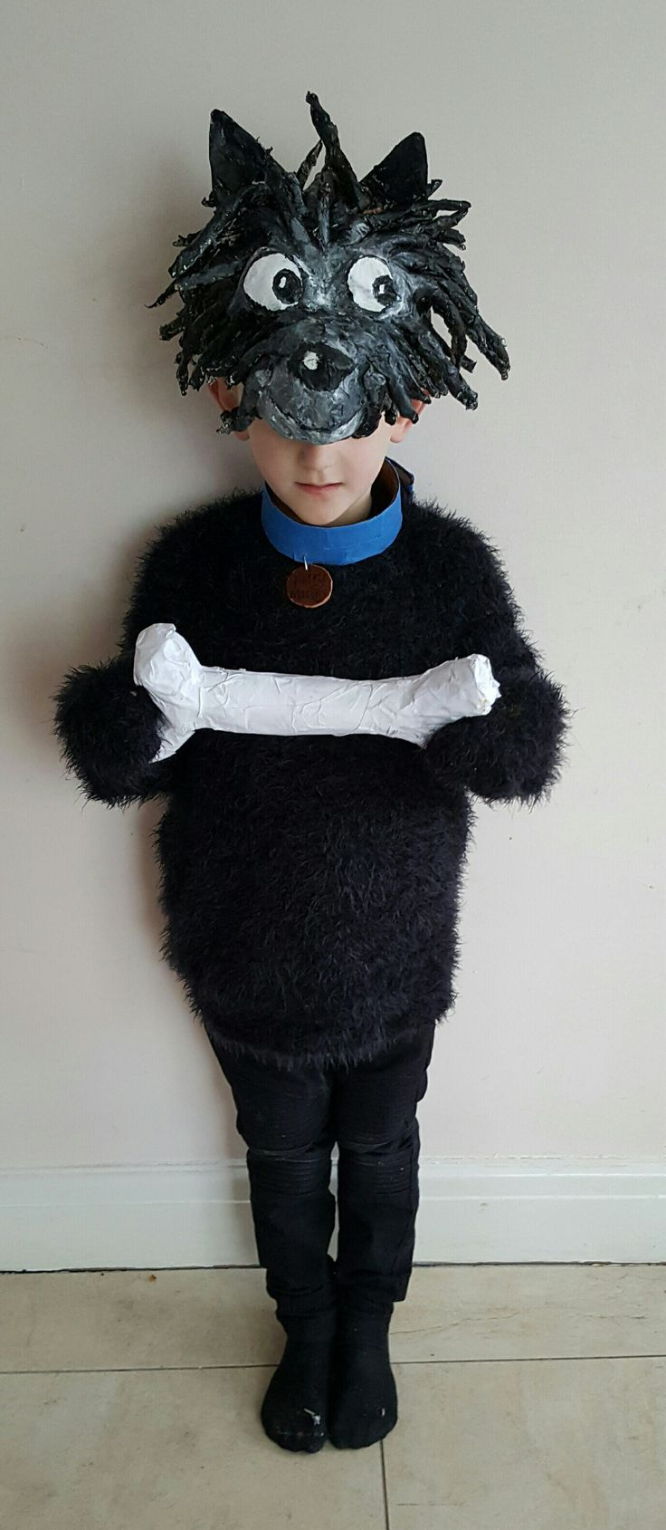 Hairy Maclary, with bone for World Book Day. Papier Mache head and bone.