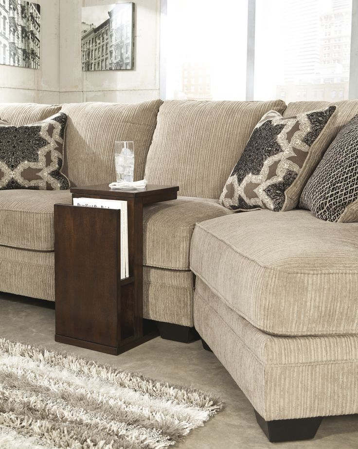 Love this versatile end table that slides under your sofa!! By Ashley Furniture #SheelysFurniture