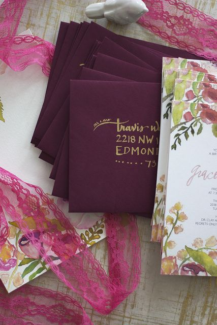 Gold ink on wine colored envelope by Gloria Joy Ink