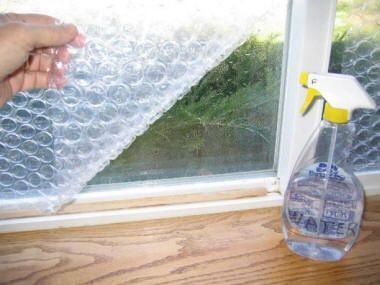 Insulate Your Windows For Winter With Bubble Wrap  Water. Also hang a clear, heavy duty shower curtain behind drapes to help keep out the cold.