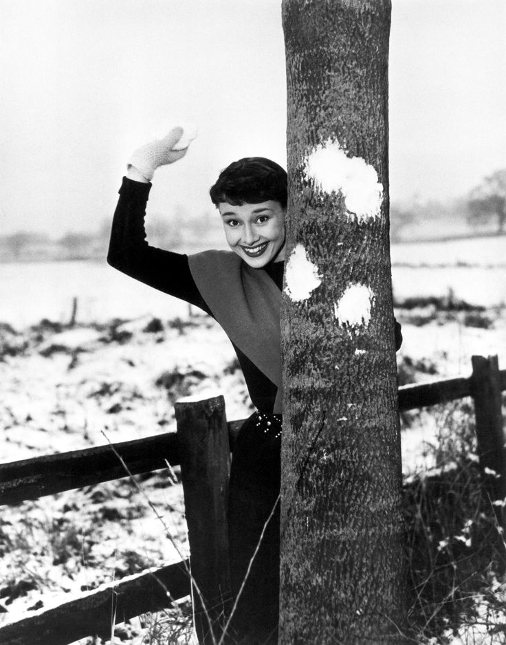 Rare Audrey Hepburn — Audrey Hepburn playing in the snow circa 1951.