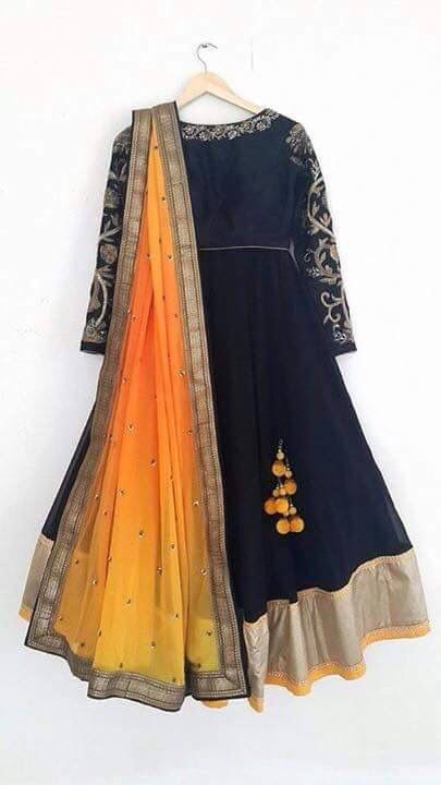 Black Anarkali with embroidery around neck n sleeves with plain gold border with contrast dupatta in shades of dawn