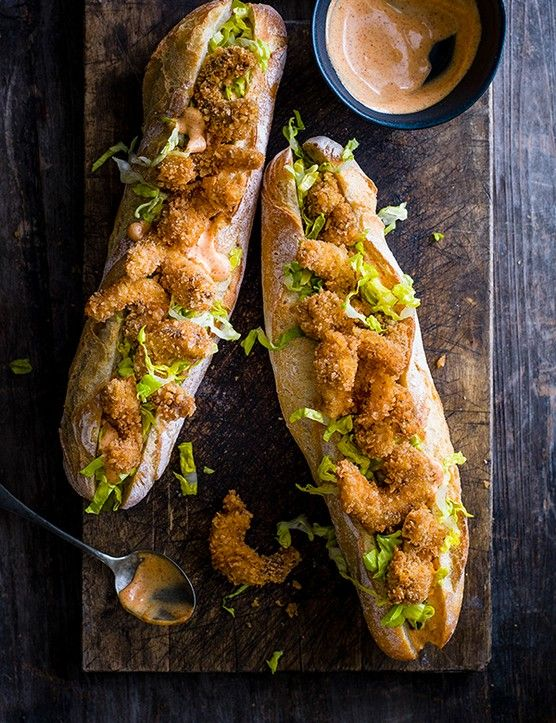 Fried shrimp po' boy sandwich  The po' boy is a New Orleans classic. The fried fillings include catfish, oysters and soft-shelled crab. What makes it extra special is the remoulade, a spiced Cajun mayo-based sauce.