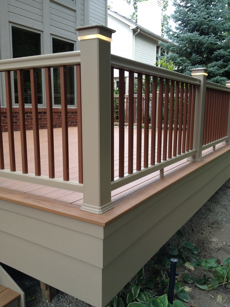TimberTech XLM PVC deck in Harvest Bronze decking with Sandridge fascia and railings.