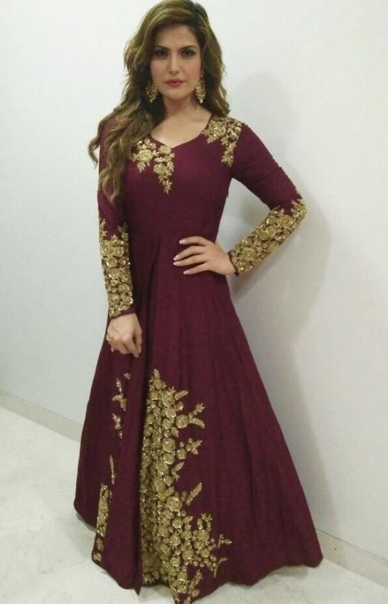 Actress Zareen Khan wearing brand Kalki in Mumbai for a wedding ceremony. She was seen wearing a majestic maroon dress with a floral embellishment from Ka