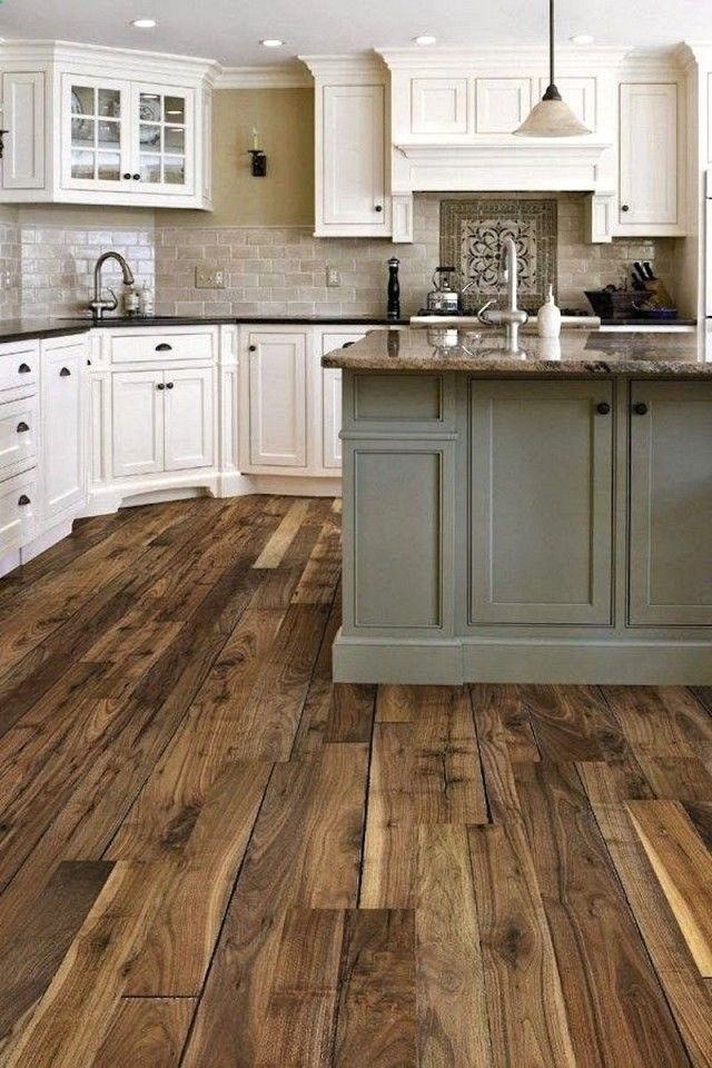 Rustic kitchen with wood floors, and a light gray island