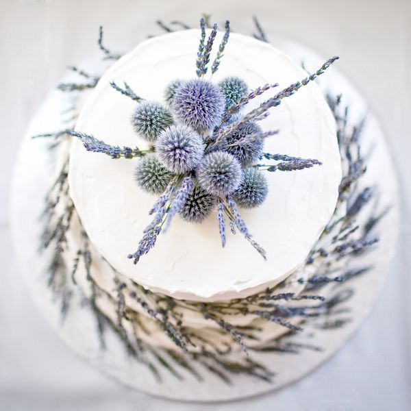 Simple white cake encircled with lavender and topped with globe thistle | Photo by Rachel Havel