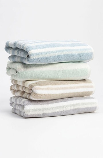 Bathroom: Replace Your Towels: Adding new towels to your bathroom, like these cotton towels ($13), adds texture and a serene appeal. Although these towels are muted, bath linens in all colors are an affordable way to switch up your current color palette.