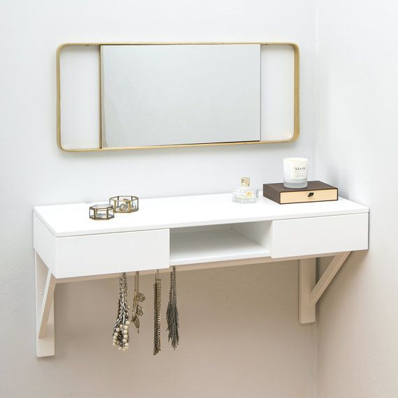 Floating dressing table. Wall mounted to maximise space in smaller rooms. Plenty of storage for all your vanity items with two drawers and a central open space. Made from solid beech wood and painted white. Jewellery rail for keeping all your jewellery tangle free and ready for wearing.