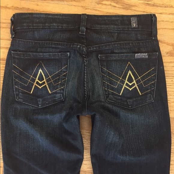 """New 7 For All Mankind Flare Dark A foil jeans 24 7 for All Mankind's classic Bootcut, is slim through the thigh and widens at the knee to a bootcut opening. Heavily saturated and faded from front to rear, with whiskering and tonal hardware, Monte Carlo reflects the deep navy tones of the Mediterranean. The signature """"A foil""""on the back pockets complete this classic look.""""A"""" stitching on back pockets in electric gold foil. Zip fly Cotton / elastane Machine wash cold Made in USA 7 for all…"""