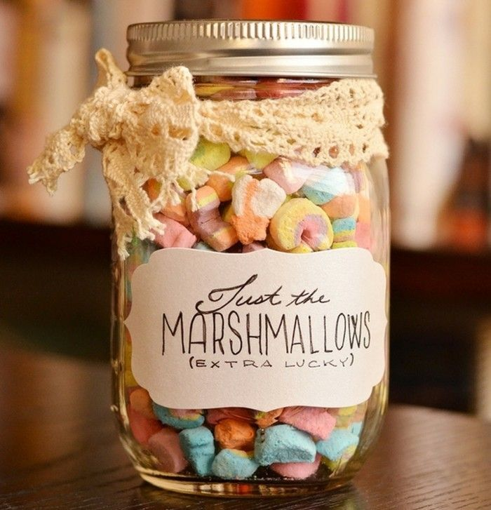 mason jar filled with small multicolored marshmallows, with silver lid and white hand-written label, tied with a cream lace bow